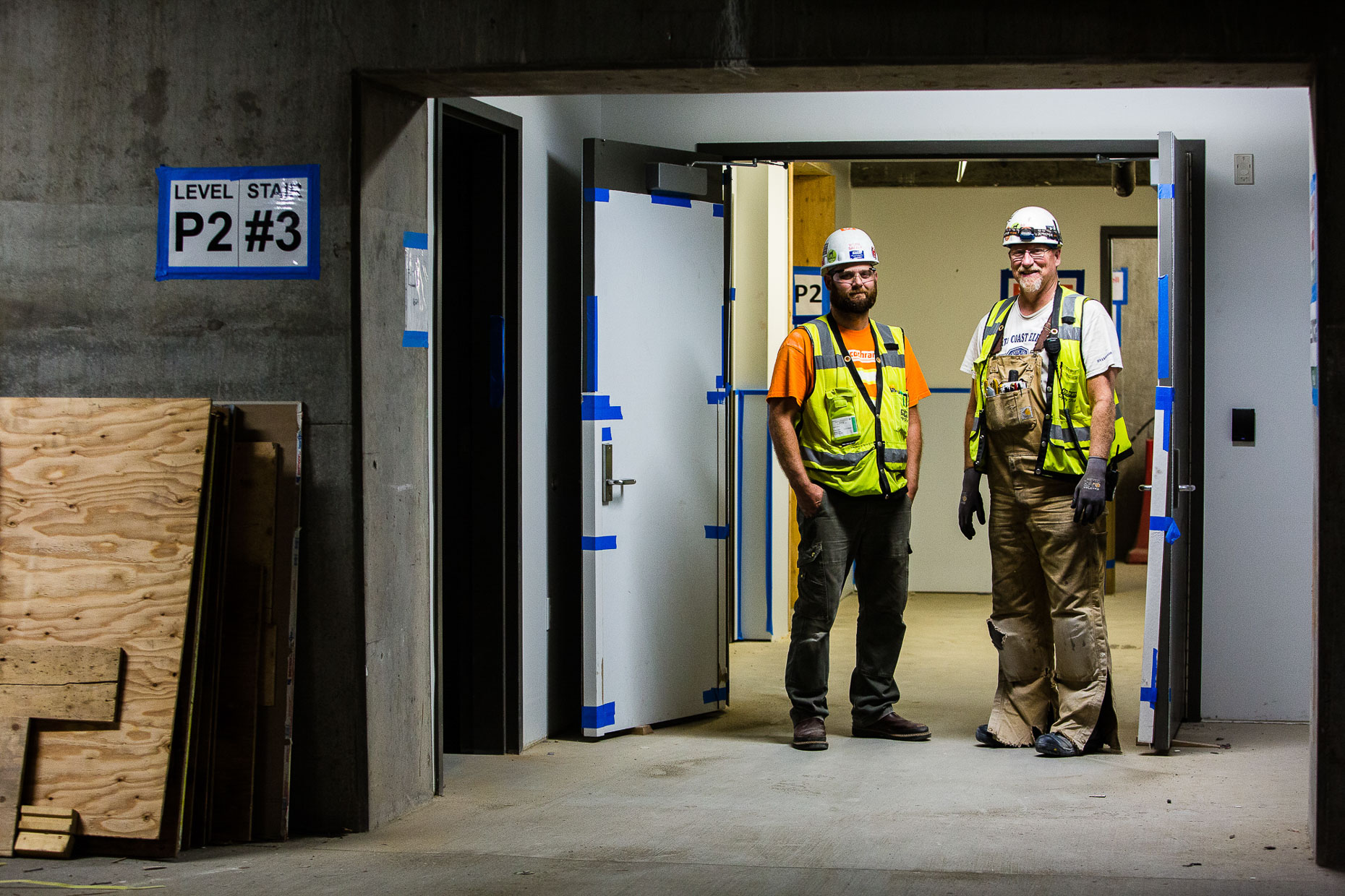 Construction managers at a job site in Seattle, industrial photography by Jed Share Images